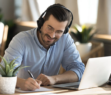 Man At Desk In Training Session